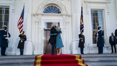 President Joe Biden and first lady Jill Biden embrace in front of the White House in Washington