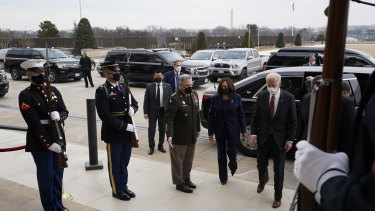 US President Joe Biden, from right, Vice-President Kamala Harris and Mark Milley, chairman of the joint chiefs of staff, arrive at the Pentagon in Arlington, Virginia.