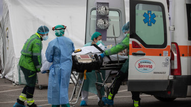 Medical workers treat a COVID-19 patient in Cremona, near Milan.