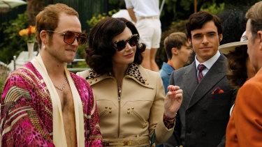 Taron Egerton as Elton John, Bryce Dallas Howard as  Elton's mother Sheila Farebrother and Richard Madden as John Reid in Rocketman.