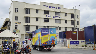 Transport truck from Top Glove enter Top Glove factory in Shah Alam, Malaysia.