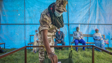 A member of the Tigray Special Forces casts his vote in a local election in the regional capital Mekelle in September. The Ethiopian government declared the election illegal.