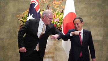 Scott Morrison with Japanese Prime Minister Yoshihide Suga in Tokyo last year.