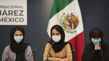 Several of the original members of the Afghan all-girls robotics team, who have received threats from the Taliban, attend a press conference after arriving at the Benito Juarez International Airport in Mexico City.