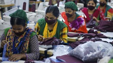 Bangladeshi garment employees wearing masks.
