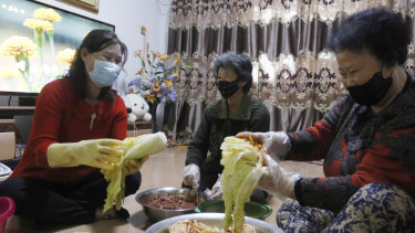 A family in Somun-dong prepares Kimchi for the coming winter with their neighbours at their home in Pyongyang, North Korea.