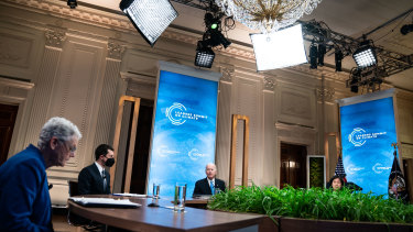 US President Joe Biden, centre, speaks during the virtual Leaders Summit on Climate in the East Room of the White House in Washington, DC.