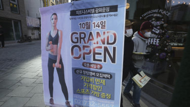 Keep the beats down: An ad of a fitness center opening sits on a street corner in Seoul, South Korea.