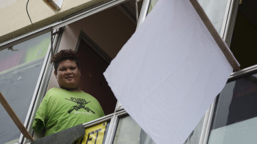 Mohamad Nor Abdullah, born without arms, put a white flag outside his rented room in Kuala Lumpur, Malaysia, to signal for help during the lockdown.