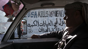 Anti-American graffiti on the street in Sanaa after the war started in 2015.