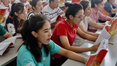 Young Uighurs study Chinese law at the Atushi Vocational Training Centre, Xinjiang.