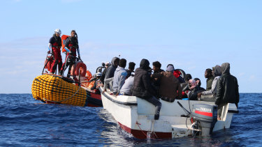 SOS Mediterranee team members from the humanitarian ship Ocean Viking approach a boat in distress with 30 people on board in the waters off Libya on December 16.
