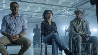 Ryan Reynolds (left), Salma Hayek and Samuel L. Jackson in a scene from The Hitman's Wife's Bodyguard.