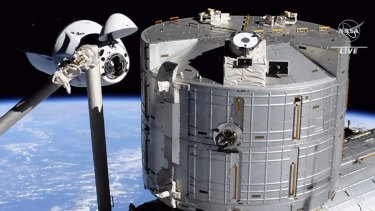 Elon Musk's SpaceX Crew Dragon spacecraft, left, docking with the International Space Station.