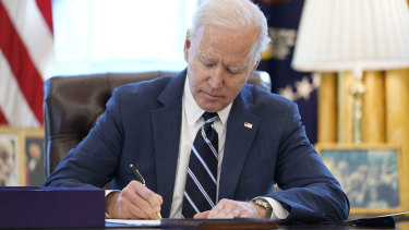 US President Joe Biden as he signed the American Rescue Plan, a coronavirus relief package, in the Oval Office of the White House on Thursday.