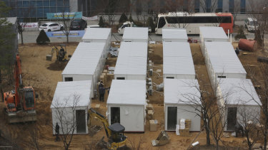 Containers to be used as a ward to treat people infected with the coronavirus are set up on the grounds of the Seoul Medical Center.