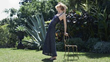 Elizabeth wears Chanel dress. Rings from Greene & Greene Antiques. Chair from Ici et Là.