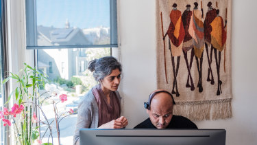 Rahul Desikan, with his wife Maya Vijayaraghavan, communicates using eye movement to type on his computer.