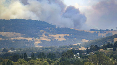 Smoke billows from a wildfire south of Huonville in southern Tasmania on Tuesday.