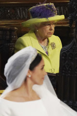 Queen Elizabeth looks on as she acquires a new grand-daughter in law.