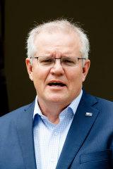 Morrison addresses the media on Sunday outside Kirribili House.