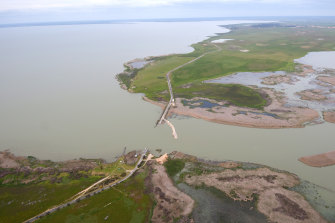 An aerial view of the Narrung bund as it was being dismantled to let water flow into Lake Alexandrina, in the lower Murray River region.