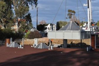 One of the four fish screens is lowered into a canal at Cohuna in northern Victoria.