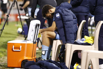 A dejected Milos Ninkovic on the bench after Sydney's loss to Western United.