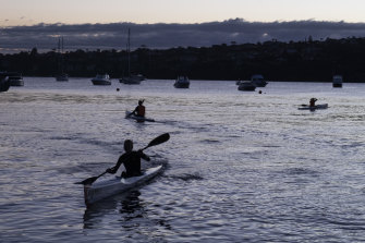 Early morning paddlers from the Sydney Harbour Surf Club out on the water near Rose Bay.