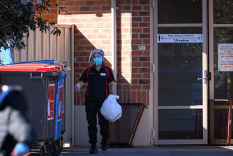 A worker at the Blue Cross Western Gardens facility in Sunshine on Monday.