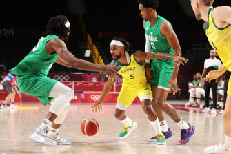 Patty Mills looks to find some space as the Nigerians close him down.