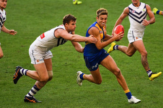 Brad Sheppard is tackled by Sean Darcy of the Dockers.