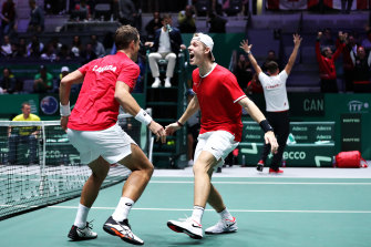 Canada celebrate their Davis Cup win over Australia.