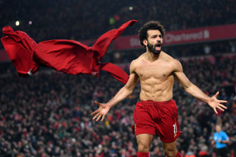 Mo Salah celebrates his stoppage-time goal for the Reds.