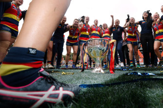 Adelaide celebrate their AFLW premiership in 2019.