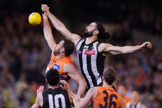 More appreciation required: Magpie Brodie Grundy reaches over Shane Mumford.