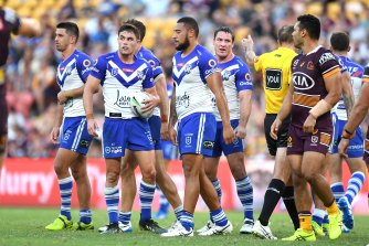 Dejected Bulldogs players during the defeat to the Broncos in March.