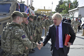 British PM Boris Johnson, then the foreign minister, greets British soldiers in Kabul, Afghanistan, 2018.