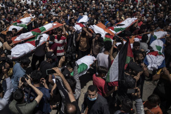 Palestinians attend the funeral of two women and eight children of the Abu Hatab family in Gaza City, who were killed by an Israeli air strike, on Saturday, May 15.