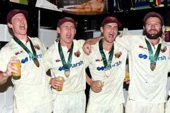 Brendan Doggett, Marnus Labuschagne, Mitch Swepson and Michael Neser of Queensland  celebrate.