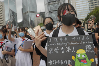 A student wears an eye patch to show solidarity with a woman injured by a police projectile in Hong Kong.