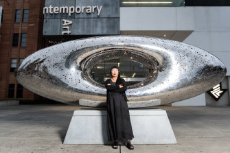 Lindy Lee with her work 'Secret World of a Starlight Ember' which is installed in the forecourt of the MCA.