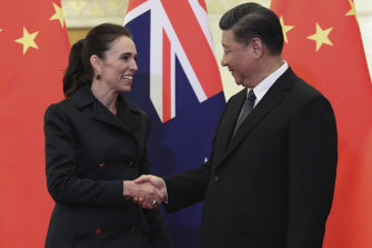 Chinese President Xi Jinping, right, and New Zealand Prime Minister Jacinda Ardern shake hands before their meeting at the Great Hall of the People in Beijing in April.