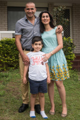 New life: Kosar, Eric and Hossain at home in Brisbane.
