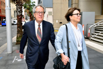 Geoffrey Rush, with his wife Jane Menelaus,  at the Federal Court in Sydney on Monday.