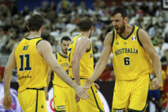 Andrew Bogut (right) celebrates with teammate Nic Kay during the quarter-final win over the Czech Republic.