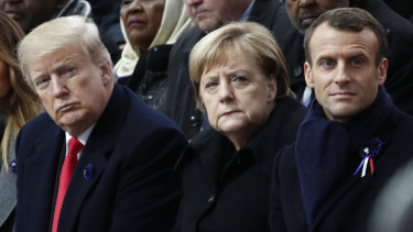 French President Emmanuel Macron, German Chancellor Angela Merkel and President Donald Trump attend a commemoration ceremony for Armistice Day in Paris.