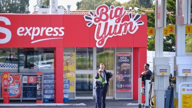Police are seen at the Coles Express petrol station at the corner of Kings Road and Melton Highway.