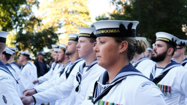 Navy servicemen and women march down St Georges Terrace.