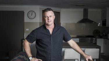 Shane Bywater stands in his Wattle Grove home in Sydney's South West. He has been asked by over 150 people to be a referee on their CVs.
